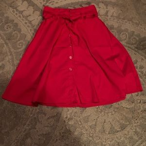 Red skirt with belt tie and buttons up the front